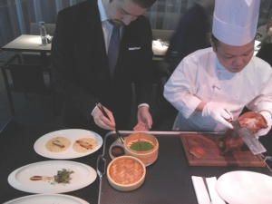 Carving a duck at HKK is a two-man job